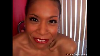 Mature black babe has big tits
