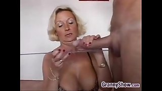 Horny Grandma With Two Cocks..