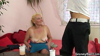 Old blonde grandma enjoys..