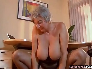 Busty Granny Seduces Young..
