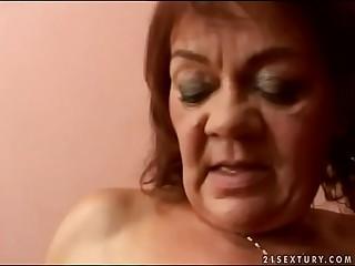 Hairy granny Marsha fucks in..