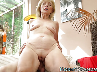Mature cougar with small..