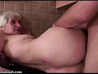 Granny fucks in  kitchen