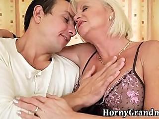 Blonde granny rides cock